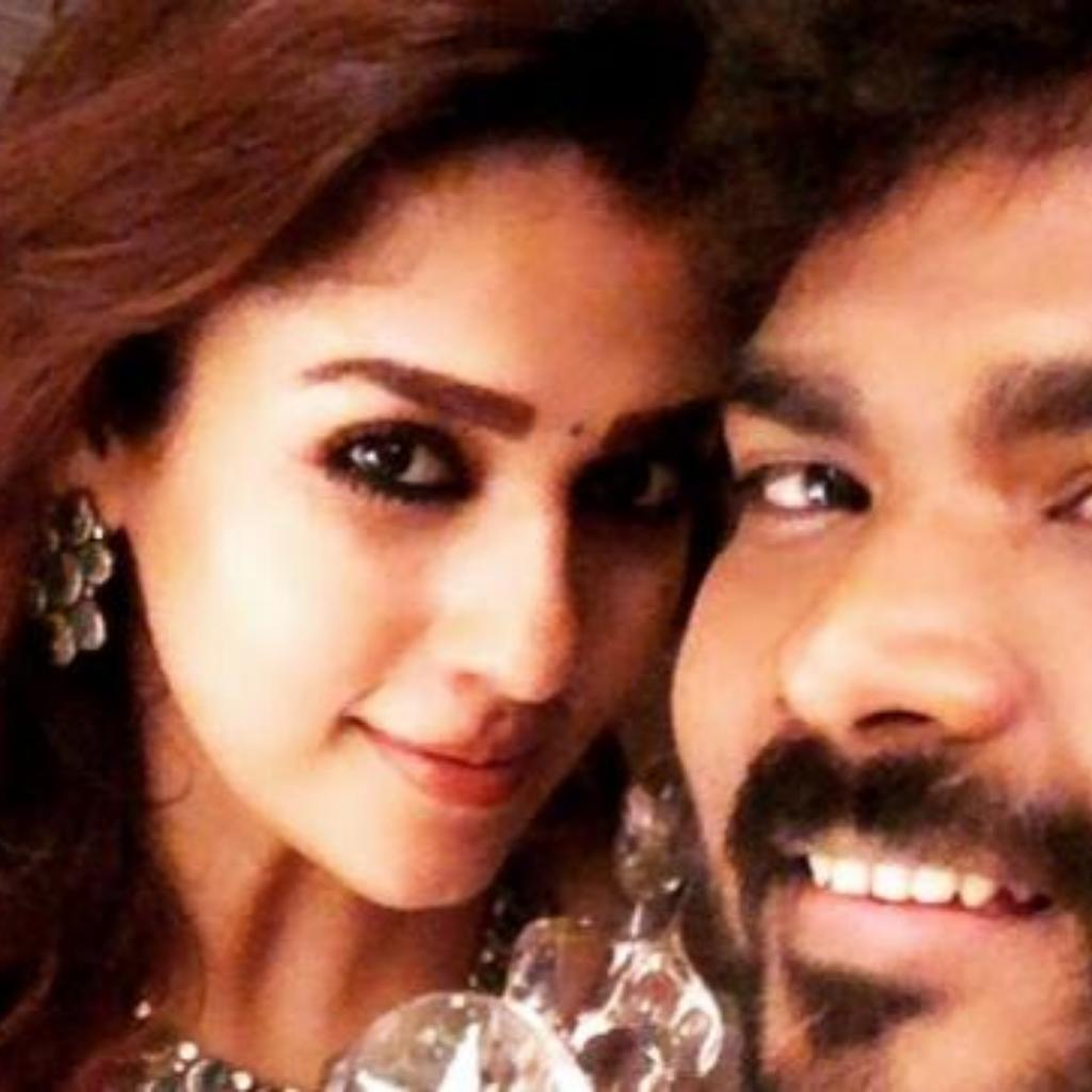 Nayanthara and Vignesh with an award