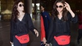 Alia Bhatt adds Rs 45k red bag to all-black airport look. See pics