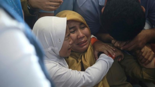 Relatives of passengers comfort each other as they wait for news on a Lion Air plane that crashed off Java Island at Depati Amir Airport in Pangkal Pinang, Indonesia.
