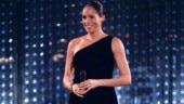 Pregnant Meghan Markle glows in off-shoulder thigh-slit black dress. See pics