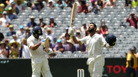 Cheteshwar Puajra and Virat Kohli stitched a 170-run stand for the third wicket at the MCG (Reuters Photo)