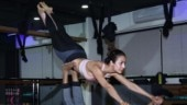 Malaika Arora nails mid-air yoga pose in pink sports bra and black tights