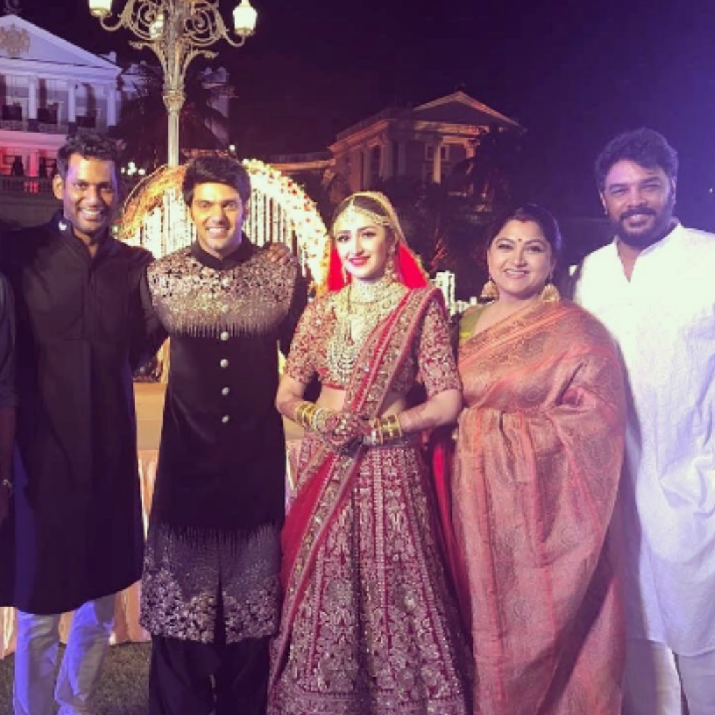 Vishal, Sundar C and Kushboo with the couple