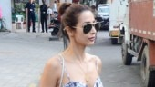 Malaika Arora slays casual look in thigh-high slit dress and Rs 1.2 lakh bag. See pics