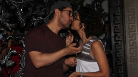 Aamir Khan and Kiran Rao kiss on the actor's 54th birthday bash in Mumbai. Photo: Yogen Shah