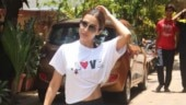 Malaika Arora is feeling all loved up in midriff-baring crop top at the gym. See pics