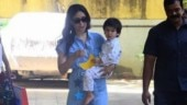 Taimur Ali Khan is happily nestled in Kareena Kapoor Khan's arms on day out. See pics