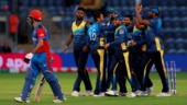 Sri Lanka players celebrate the run-out of Najibullah Zadran in Cardiff