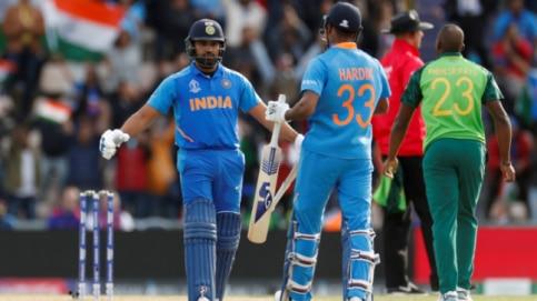 Rohit Sharma celebrates India's win with Hardik Pandya