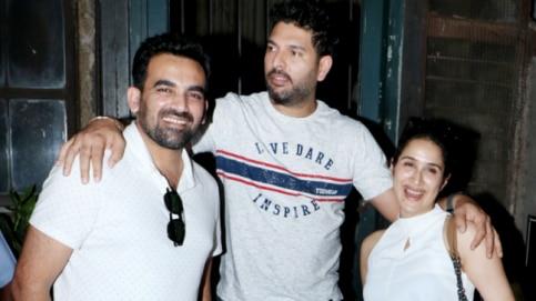 Sagarika Ghatge and Zaheer Khan with Yuvraj Singh