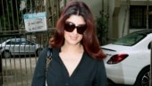 Twinkle Khanna turns up the glam quotient in plunging neckline shirt and pants on day out. See pics
