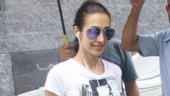 Malaika Arora beats monsoon blues with workout session in figure-hugging monochrome attire. See pics