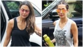 Malaika Arora is all about fierce femininity in top and mini shorts with Amrita Arora at gym