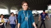 Raveena Tandon adds dash of antique silver to stunning blue dress at Mumbai airport