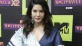 Sunny Leone is pretty in plunging neckline mini jumpsuit at an event. See pics
