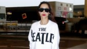Malaika Arora shows how to do classic hot red lips with white top and denims at airport. See pics