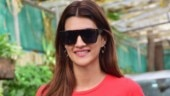Kriti Sanon is perfect mix of casual and classy in slogan tee and mini skirt on day out. See pics