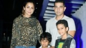 Amrita Arora makes a fashion blunder in animal print shirt and jeans on date night with hubby and kids