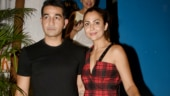 Amrita Arora makes date night sexy in off-shoulder top and pants with knee-high boots. See pics