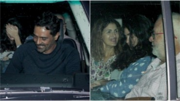 Arjun Rampal (L) and Gabriella Demetriades with her parents