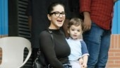 Sunny Leone is mommy goals in classic black top and denims on day out with kids