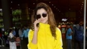 Urvashi Rautela teams bright yellow jacket with cream skirt at Mumbai airport. Why though?