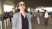 Karisma Kapoor shows who is the boss in mini shirt dress and Rs 7 lakh bag. See pics