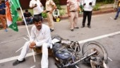 Congress youth bring old bikes to destroy in protest against new traffic fines: Photos