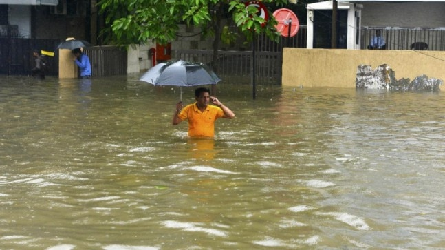 Mumbai rains in photos: Trains cancelled, flights delayed, routine stalled in Maximum City