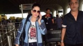 Sunny Leone pairs smart jacket with tee and denims at Mumbai airport. See pics