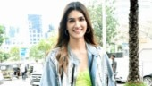 Kriti Sanon pairs smart denim jacket with neon green dress for Housefull 4 promotions. See pics