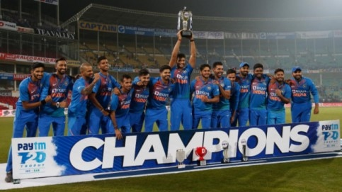 Indian cricket team poses with the winner's trophy after their win in the third T20I against Bangladesh