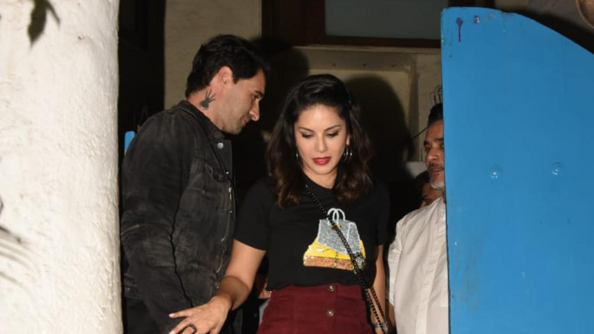 Sunny Leone with husband attending a party Photo: Yogen Shah