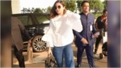 Anushka Sharma is classy in white shirt and blue denims at Mumbai airport. See pics