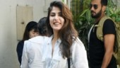 Rhea Chakraborty gives sexy twist to camouflage cargo pants with knotted white shirt. See pics