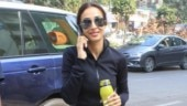 Malaika Arora in crop jacket and tights rocks the all-black look in style. See pics