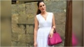 Nargis Fakhri in sleeveless white dress adds a pop of colour with fuchsia pink bag on day out