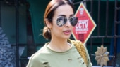 Malaika Arora pairs T-shirt and camouflage pants with boho bag. Queen of fitness fashion, we say