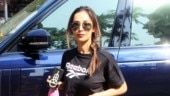 Malaika Arora in crop top and mini shorts gives sexy twist to casual gym look. See pics