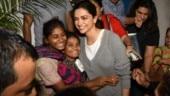 Deepika Padukone wins hearts as she hugs street kidsin Mumbai, calls it joys of life