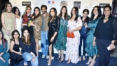 Shah Rukh Khan poses with wife Gauri Khan and her girl gang at an event. See pics