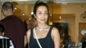 Malaika Arora in crop top and pants just raised the bar for casual fashion on day out. See pics