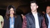 Priyanka Chopra in shirt and flare pants with blazer keeps it chic at airport with Nick Jonas