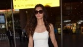 Diana Penty in white ganji and pants does the airport look right. See pics