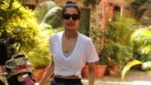 Malaika Arora in crop top and mini shorts aces fitness fashion. See pics