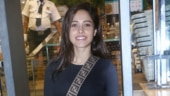 Nushrat Bharucha pairs smart sling bag with crop top and pants on day out. See pics