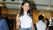 Rakul Preet in white top and embellished mini shorts does night-out look right. See pics