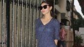 Mouni Roy is chic in blue mini dress and white sneakers on day out. See pics