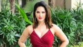 Sunny Leone is sensuous in maroon dress for event in Mumbai. See pics