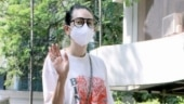 Karisma Kapoor in t-shirt and denims with Rs 2.9 lakh bag heads to Kareena's house